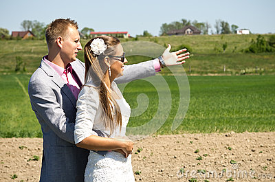 Fashionable couple in country