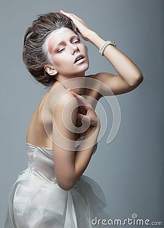 Fashionable emotional artistic female posing