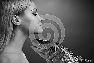 Fashionable girl with big fish