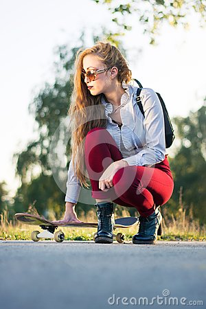 Free Fashionable Girl With A Skateboard In The Park Royalty Free Stock Image - 108702186