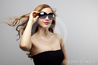Fashionable lady wearing sunglasses