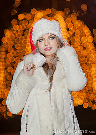 Free Fashionable Lady Wearing Xmas Hat And White Fur Coat Outdoor. Portrait Of Young Beautiful Woman In Winter Style. Bright Picture Royalty Free Stock Photos - 36417438