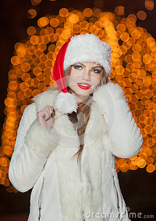 Free Fashionable Lady Wearing Xmas Hat And White Fur Coat Outdoor. Portrait Of Young Beautiful Woman In Winter Style. Bright Picture Stock Photo - 36417450