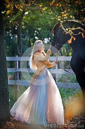 Free Fashionable Lady With White Bridal Dress Near Black Horse In Forest.   Royalty Free Stock Photo - 58036435