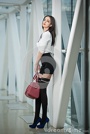 Fashionable Model In Steel And Glass Space Stock Photo