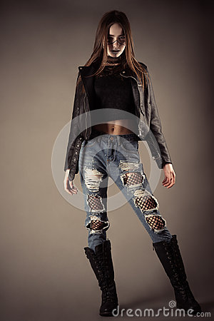 Free Fashionable Teenager Girl In Leather Jacket And Torn Jeans Stock Photo - 95328570