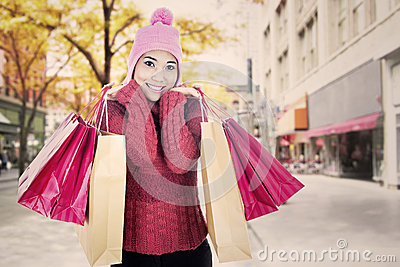 Fashionable woman with bags