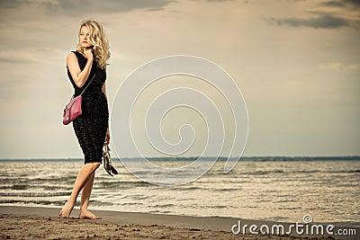 Fashionable woman on beach.