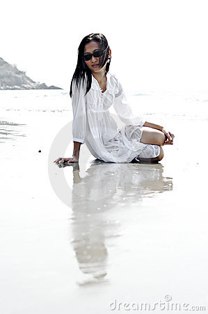 Fashionable woman on beach
