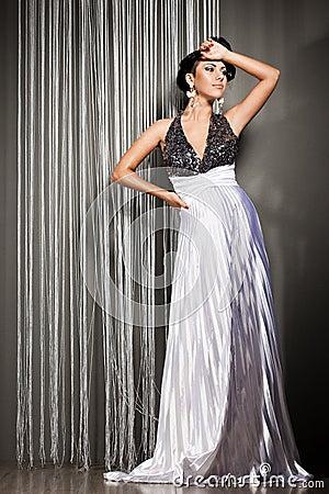 Fashionable woman in beautiful dress