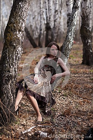 Fashionable woman in forest