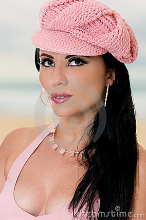 Fashionable woman in pink cap