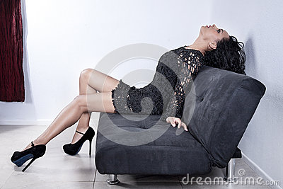 Fashionable woman on sofa