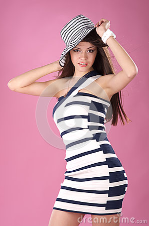 Fashionable woman in stripped hat and dress