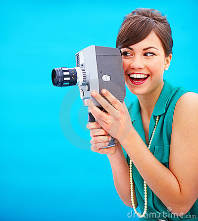Fashionable woman using an old fashioned camera