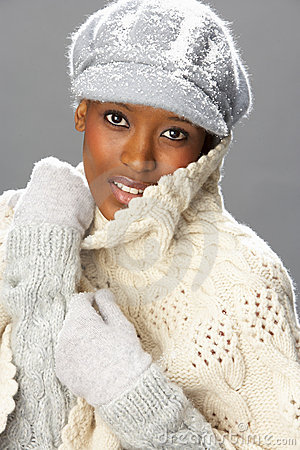 Fashionable Woman Wearing Knitwear In Studio
