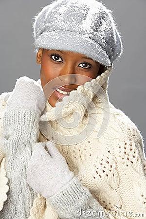 Fashionable Woman Wearing Knitwear In Studio