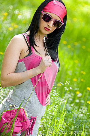 Fashionable young brunette with sunglasses