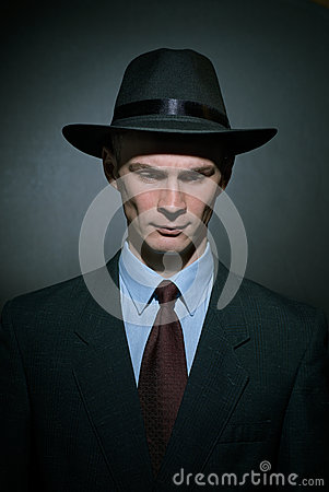 Free Fashionable Young Man Detective In A Stylish Hat Royalty Free Stock Images - 82224329