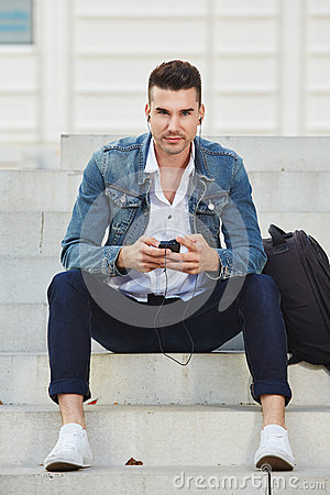 Free Fashionable Young Man With Phone Listening To Music Royalty Free Stock Photos - 83894528