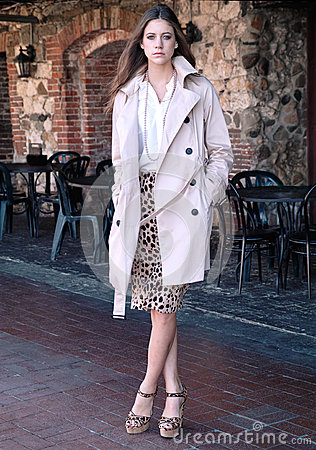 Fashionable Young Woman By Outdoor Cafe