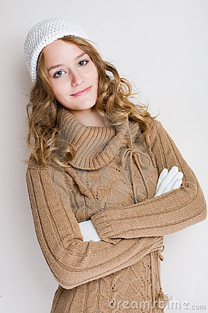 Fashionable young woman in winter outfit.