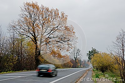 Fast black car on a straight road
