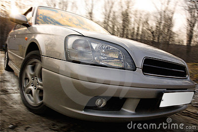 Fast car on country road with motion blur effect.