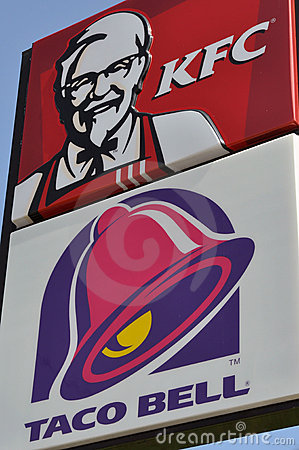 Fast food restaurants - Taco Bell and KFC signs Editorial Stock Photo