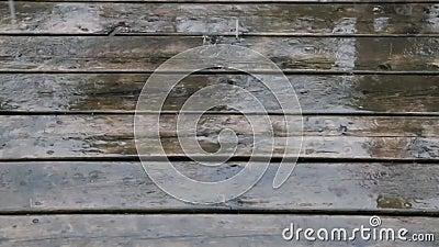 Fast, Heavy Rain Falls on a Wooden Deck stock video