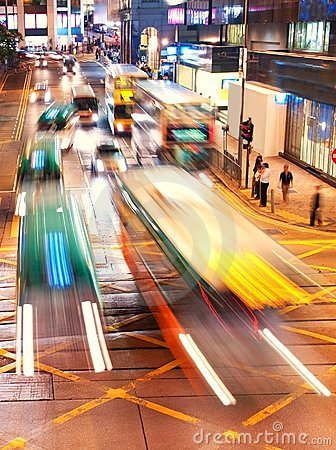 Fast moving cars at night time Stock Photo