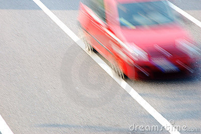 Fast moving red car