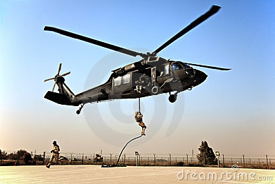 Fast roping down a Blackhawk Editorial Stock Photo