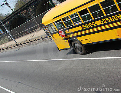 Fast School Bus Speeding in an Urban City Street