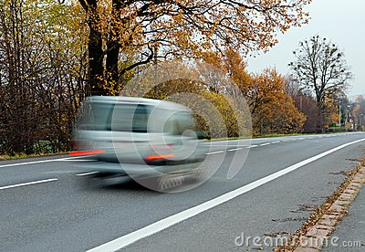 Fast silver car on a straight road