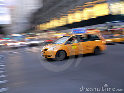 Fast taxi cab mini van in New York City