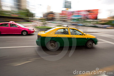 Fast taxi in city traffic