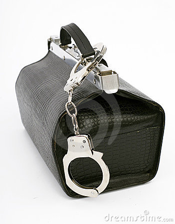 Fastened handcuffs pinned to bag