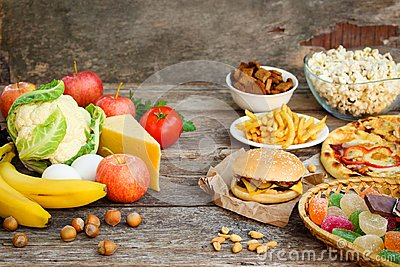 Fastfood and healthy food. Concept choosing correct nutrition or of junk eating. Stock Photo