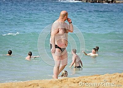 Fat beach man Editorial Stock Image