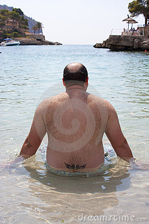 Fat man on the beach
