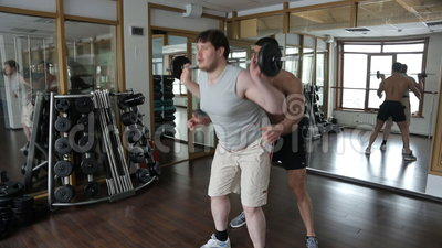 The Fat Man Is Doing Physical Exercises With A Help Of ...