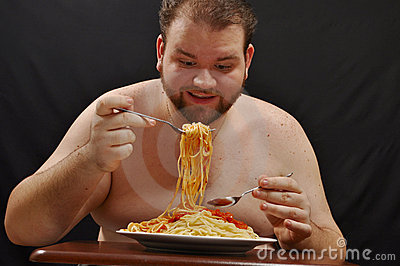 Fat man eating pasta