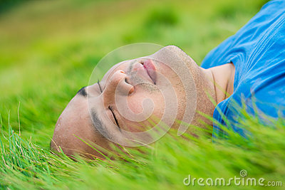 Fat Man Lying on the Green Grass to Relax