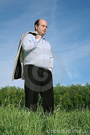 Fat man on a meadow