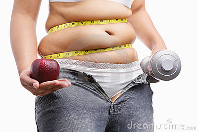 Fat woman holding apple and weight on each hand