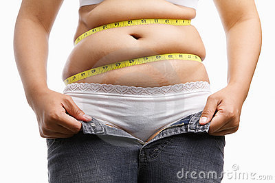 Fat woman holding her unzip jeans