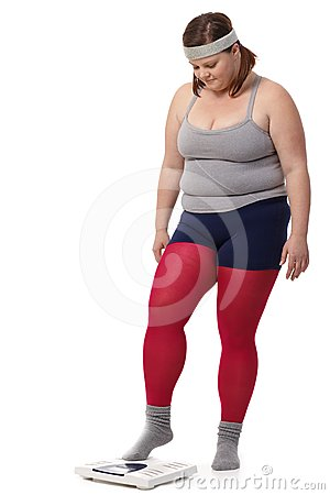 Fat woman stepping on scale