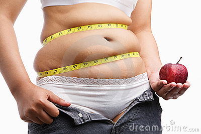 Fat woman with unzip jeans holding apple