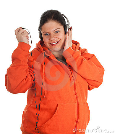 Fat young woman with headphones and mp3 player